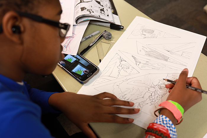 Comic Book Art and Manga camps at KSU teach kids to create their own story and characters.