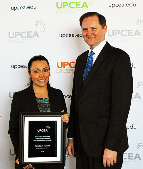 Natalia poses for a photo with UPCEA CEO Bob Hansen after the award ceremony April 8.