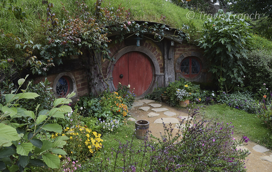 "This well-lit photo of a hobbit hole in New Zealand's ""Shire"" is an example of properly exposed photo where all details are clearly visible to the viewer."