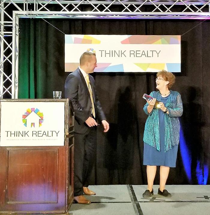 Jan Britt receives Think Realty educator award