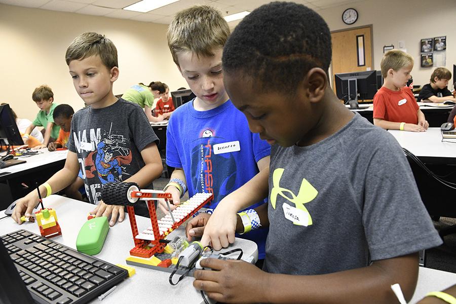 Campers enjoy Tykes and Bytes LEGO Robotics at Summer U.