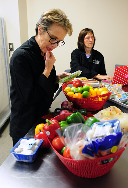 Wendy Kupcewicz considers what produce to choose for her Mystery Basket entree.