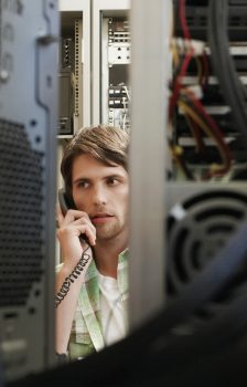 Man in Sever Room on Telephone