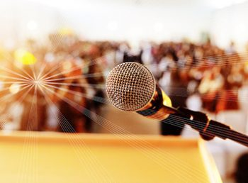 Stepping up the the microphone at an event